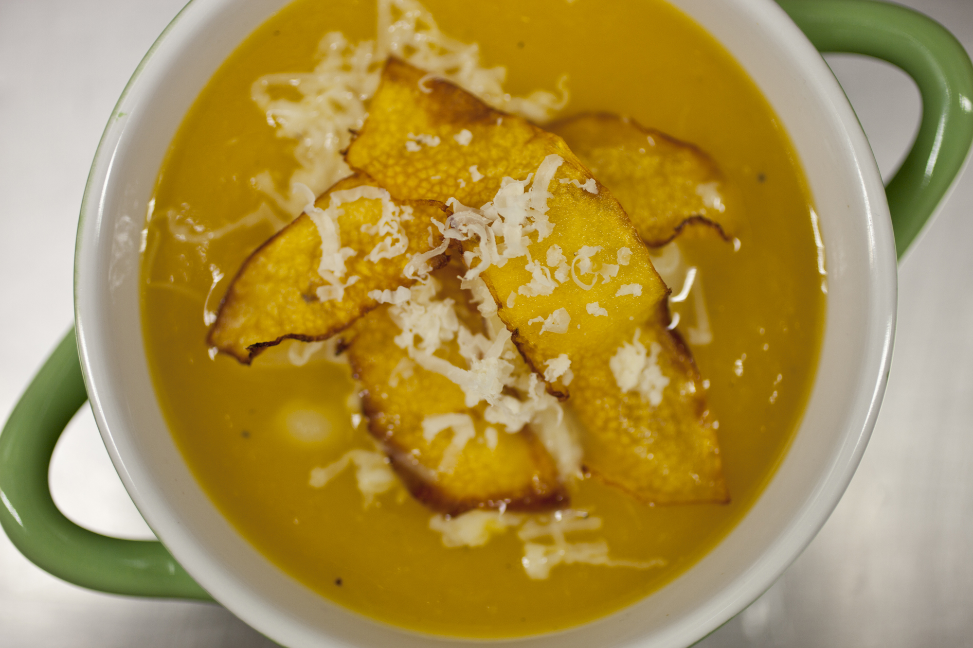 Pour soup into bowls, add pumpkin dice and top with gruyere cheese and ...